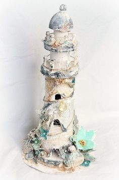 Stacey Young brings the seaside to you with this beautiful mixed media lighthouse.