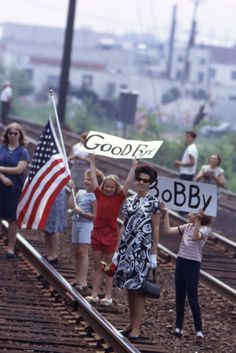 """""""The blow was monumental. Hope-on-the-rise had again been shattered and those in most need of hope crowded the tracks of Bobby's last train stunned into disbelief and watched that hope trapped in a coffin pass and disappear from their lives,"""" reads a quote from Paul Fusco on the final page of his critically-acclaimed photo-book RFK Funeral Train. Reportage Photography, Strikes Again, Presidential Candidates, Coffin, Funeral, Photo Book, Bobby, Quote, Train"""