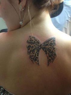 Leopard bow tattoo