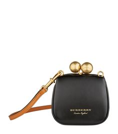 61e0143f3627 Burberry Mini Leather Metal Frame Clutch Bag available to buy at Harrods. Shop for her online and earn Rewards points.