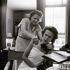 Eileen Ford in her model agency, as a masseuse works on her shoulders. Photo: Nina Leen for LIFE Magazine, 1948.