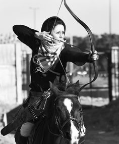 "dirtylostkitten: "" Iranian archer Shiva Mafakheri aims at a target during horseback archery competitions, in Tehran, on May 28, 2011. (AP Photo/Vahid Salemi). Converted to black and white and contrast..."