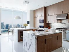 The kitchen has cerused-oak cabinetry and a nickel-tile backsplash
