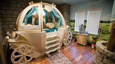Cinderella's Coach as a bed and your very own wishing well. what little girl wouldnt love this bedroom!
