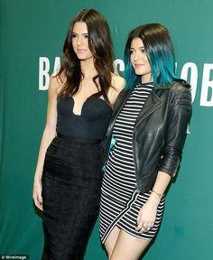Punk girl: Kylie Jenner displayed her neon blue hair as she posed alongside her older sister Kendall Jenner