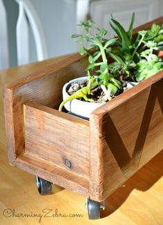 DIY Wood Planter on Wheels. @ CharmingZebra.com VERY NICE SITE, AND A VERY GOOD TUTORIAL, NICE LOOKING AND PRACTICAL PROJECT, COULD BE USED WELL BY THOSE THAT LOVE HOUSEPLANTS AS THIS PROJECT MAKES MUCH POSSIBLE RE: SUNLIGHT