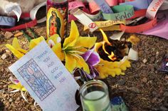 """A close-up view of some of the grassroots memorial items placed at Congresswoman Gabrielle Giffords' office in the wake of the shootings of January 8, 2011 in Tucson, Arizona. A gunman opened fire at Giffords' """"Congress on Your Corner"""" event, killing six people and wounding 19 others, including Giffords. Photo by Barbara Loving."""