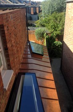 The extension is clad is Bronzed Copper from Aurubis. This provided the perfect accompanyment to the existing brick walls and will naturally weather to develop a darker orange/brown patina