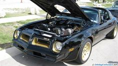 Pontiac Firebird Trans Am with carbureted twin turbos . As seen at the April 2013 Cars and Coffee show in Austin TX USA.