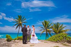 Intimate Weddings in Barbados,on a cliff top with the view of the Atlantic ocean and blue skies.