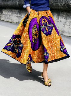 African Print: Mustard and purple full midi skirt / blue sweater / blue and white striped shirt / yellow pumps shoes / yellow / paisley African Inspired Fashion, African Print Fashion, African Prints, Ankara Fashion, Fashion Prints, Fashion Dresses, Fashion Mode, Look Fashion, Fashion Design