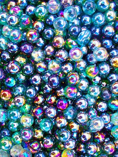 Iridescent is my favorite color :) / Would be so cool to set a garden path in iridescent marbles! Instalation Art, Tamara, Glass Marbles, Blue Marbles, Textures Patterns, Wallpaper Backgrounds, Glitter Wallpaper, Iphone Wallpaper, Rainbow Colors