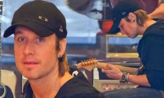 Keith Urban jams away at guitar shop on day off from Raise Em Up tour