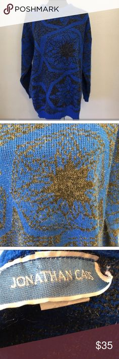 Vintage metallic blue black oversized sweater Vintage oversized Sweater. 100 percent acrylic. Has metallic threads. 22 arm to arm and 28 shoulder to hem. Size large. But can be worn from small to large. Sweater has some pilling. Looks great on. Perfect for leggings. Made in the USA 🇺🇸 1980s Vintage Sweaters Crew & Scoop Necks