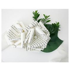 Book page boutonnières for your studious husband to be.