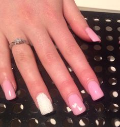 Baby pink gel extensions with hearts and chunky white sugar glitter