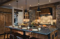 Love the idea of one wall of stone in the kitchen and we have the perfect wall!