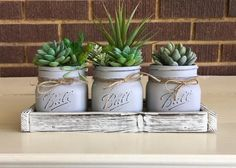 mason jar crafts Give your home or office a farmhouse style with these charming faux succulents in mason jars and planter box. This mason jar is perfect for any room in your home and w Pot Mason Diy, Rustic Mason Jars, Mason Jar Gifts, Mason Jar Kitchen Decor, Kitchen Rustic, Country Kitchen, Artificial Succulents, Faux Succulents, Mason Jar Succulents