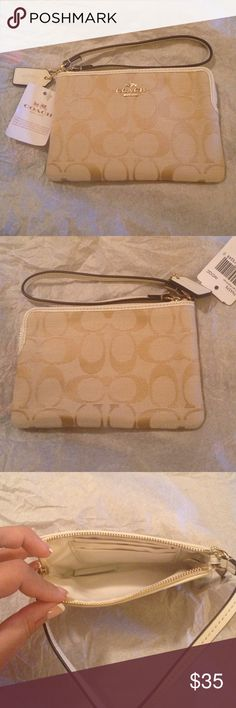 Coach 12cm signature corner zip NWT Coach 12 cm wristlet light khaki and white. The material is canvas, and the inside has 2 slots to hold credit card and a identification card. It is brand-new with tags's the retail rate is $65. Coach Bags Wallets