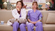 Sandra Oh as Cristina Yang and Ellen Pompeo as Meredith Grey on Grey's Anatomy