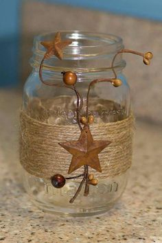 Jar decorated with twine and rustic doo-dads