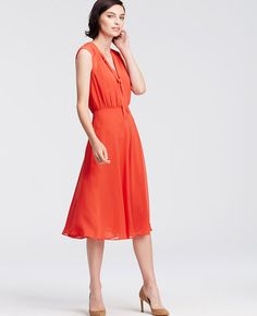 "In flowy chiffon, this sartorial standout is topped with a refined tie neck for endless styling possibilities. V-neck with shirred mandarin collar and ties. Cap sleeves. Shirred waist seam. Lined. 29"" from natural waist."
