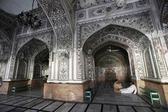 People rest in a historical Mohabat Khan mosque during a hot afternoon in Peshawar.