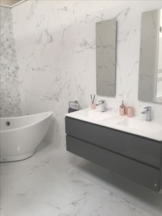 Bright White Marble Wall And Floor Tiles With Mosaic Feature Sanitary Ware By Porcelanosa