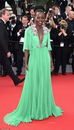 Seeing green: Lupita Nyong'o, 34, topped many best-dressed lists in 2014 during her award ...
