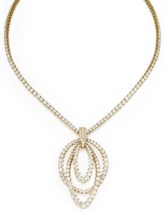 Sotheby's - 18 Karat Gold and Diamond Necklace, Piaget, and an 18 Karat Gold and Diamond Enhancer, French, Circa 1975  Estimate: 35,000 - 45,000 USD  LOT SOLD. 104,500 USD The v-shaped necklace set with numerous round diamonds weighing approximately 19.35 carats, length 16½ inches, signed Piaget, with French assay marks and workshop marks for Georland, Paris; the enhancer set with numerous round diamonds weighing approximately 18.70 carats, with French assay marks