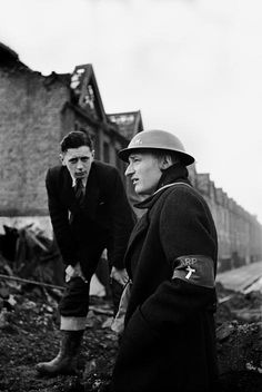 George Rodger -London. East London, West Ham. The Rev. Paul Clifford of West Ham, a particularly badly hit area, reviews his badly-battered parish. Life in London during The Blitz of World War II in 1939-40. 1940.