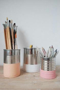 Recycled painted tin cans make a perfect pen holder. #recycle #diy
