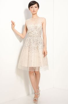 """Free shipping and returns on Alice + Olivia 'Alyssa' Embellished Dress at Nordstrom.com. <p><B STYLE=""""COLOR:#990000"""">Pre-order this style from the Spring 2012 collection! Limited quantities. Ships as soon as available. You'll be charged only when your item ships.</b></P><br>Shimmering sequins fleck the sheer mesh overlay of a pretty organza frock with a full skirt and flirty cutout back."""