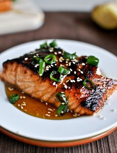 Toasted Sesame Ginger Salmon with Salmon, Olive Oil, Toasted Sesame Oil, Rice Vinegar, Brown Sugar, Soy Sauce, Garlic Cloves, Ginger, Toasted Sesame Seeds, Green Onions, Honey, Toasted Sesame Oil, Soy Sauce, Ginger, Toasted Sesame Seeds.