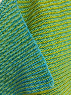 This whimsical knit blanket is the most fun blanket you will ever make! A unique technique creates a completely reversible two color blanket. The fabric is a squishy, cozy stitch pattern with no purling! Recommeded for worsted weight yarn and a circular needle. You can also make the blanket as large as you wish on any size yarn.