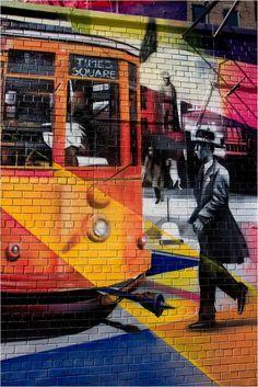 """Mural ao redor de """"Explosão de Amor"""". 2012. Mural grafitado. Eduardo Kobra (S.Paulo, SP, Brasil, 1976 - ). Encontra-se no histórico bairro de Chelsea na ilha de Manhattan, em Nova York, NY, USA."""