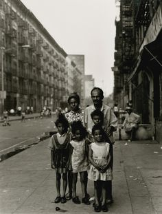 by Bruce Davidson Family on Sidewalk, c.1966. From East 100th Street.