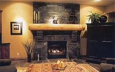 Attractive Black Stone Fireplace Love Thi Golden Wood Mantle And Gold Wall Combo Design Surround Hearth Idea Mantel Stacked Ethanol Around With Fireplace Remodel, Fireplace Mantle, Living Room With Fireplace, Fireplace Ideas, Fireplace Stone, Living Rooms, Stone Fireplace Designs, Wooden Mantle, Rock Fireplaces
