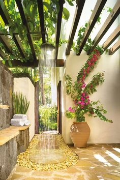 Open-air shower in the outdoor bathroom at One&Only Le Saint Géran beach hotel in Mauritius.