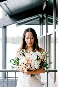 These white and peach peonies mixed with greenery is truly a bouquet for a romantic summer wedding. The white ribbon wrapped bouquet is the perfect match for the brides strapless lace wedding gown. This neutral wedding color palette is perfect for the minimalist bride. Click for some more peony wedding bouquets. // Photo: Shannon Yau Photography