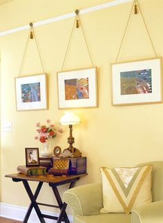 If you are like us, it is much more fun to buy art than it is to actually hang it, especially if you are renting and aren't allowed to put nails in the wall. Even if you aren't constrained by the all-powerful rental deposit, frames can get expensive and a bit boring. But never fear, we are here to rescue your awesome art with 20 creative ways to use up your vertical space and not a hammer or nail to be seen.
