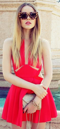 Edgier and more contemporary style + cut away red dress + Kristina Bazan + sexy and summery + winning combination Dress: Three Floor, Clutch/Shoes: Jimmy Choo.