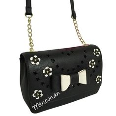 """Betsey Johnson Flower Bow Flap Crossbody NEW WITH TAGS Betsey Johnson Flower Bow Flap Crossbody.   PLEASE DO NOT RELY ON PHOTOS TO DETERMINE SIZE, ACTUAL MEASUREMENTS ARE PROVIDED   • Color: Black and Bone White • Measurements: 9""""L x 6""""H x 3""""D with 50"""" strap (23"""" Drop) • Flap snap closure • Gold tone hardware • MSRP $88.00   I have more BETSEY JOHNSON, Check out my other items!  ❌ NO TRADES ❌ PRICE FIRM   FOLLOW ME ON INSTAGRAM @MARIANNOONAN Betsey Johnson Bags Crossbody Bags"""