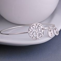 Tree of Life Bracelet, Family Tree Jewelry, Sterling Silver Tree Bangle Bracelet, Gift for Grandma by georgiedesigns on Etsy https://www.etsy.com/listing/91623596/tree-of-life-bracelet-family-tree