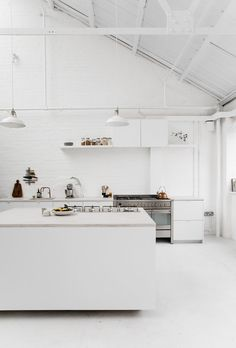 Majorly inspiring white industrial kitchen fitted with SMEG appliances