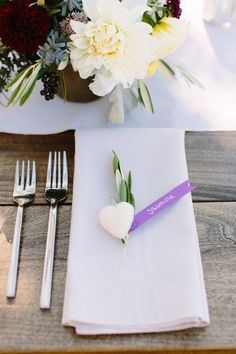 Unique wedding place setting idea - handmade felt hearts were placed at each setting {Megan Clouse Photography}