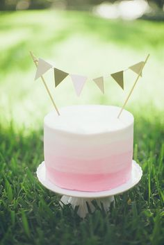 Pink Ombre Cake with Pennant Flag Banner - The Hospitality Sweet | Brides of…