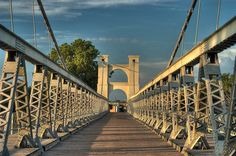 The suspension bridge was the first bridge over the Brazos River that allowed cowboys easier access to driving their cattle across the river on their way to the stockyards in Ft. Worth.