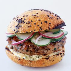 These offbeat tuna burgers were loosely inspired by a Thai fried white fish patty called tod man pla. The Thai cucumber salad stands in for pickles. U...