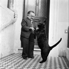 World's smallest man in 1956, Henry Behrens, dancing with his cat.